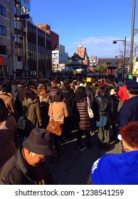 Asakusa, Japan - JAN 1, 2014: Japanese people are waiting patiently in long lines to visiting shrine or temple for the first time in the New Year.