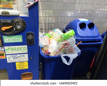 Asakusa, Tokyo, Japan - August, 23, 2019 - Blue recycle rubbish bin, garbage can overflowing with plastic pet bottle. Tourists are often confounded by Japan lack of public rubbish bins, garbage cans.