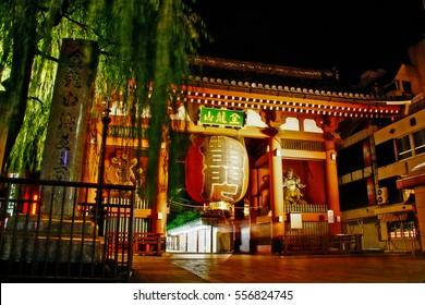 Asakusa, Tokyo, Japan - September 11, 2009 - Kaminarimon (Thunder Gate), outer entrance gate to Senso-ji (Kinryu-zan Senso-ji), with giant Chochin and statue of Fujin stand on right and Raijin on left
