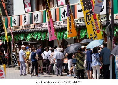 Asakusa, Tokyo, Japan-August 17, 2019: Crowd lined up at Asakusa Engei Hall, to watch traditional Japanese Rakugo and Manzai (stand-up comedy by groups). Daytime, sunny day.