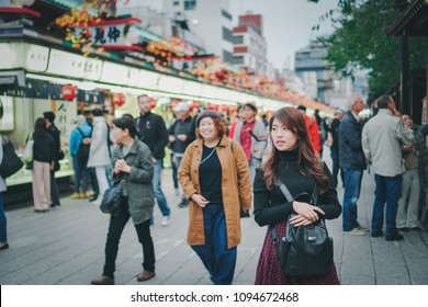 ASAKUSA,TOKYO,JAPAN - OCTOBER 25,2017 : Beautiful girl enjoying at Nakamise Shopping Street in Asakusa connect to Senso-ji Temple in Asakusa,This is the most popular place in Tokyo