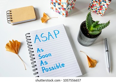 ASAP As Soon As Possible written in a notebook on white table