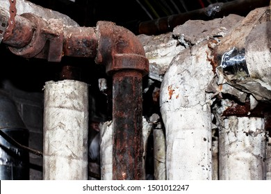 asbestos insulation on rusty pipes