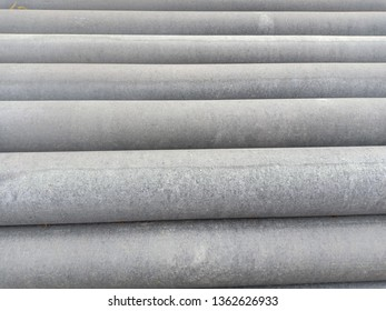 Asbestos pipes. Cement pipes for construction.