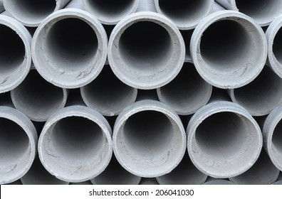 Asbestos pipes for drain in construction site.