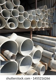 asbestos pipes stacked in a row on each other close up