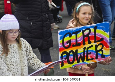 "Asbury Park, NJ - January 21, 2017: Women's March and worldwide protest; young girls with ""Girl Power"" protest sign"