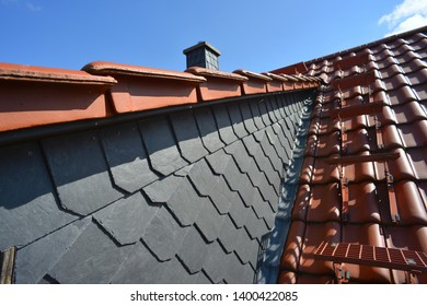 Ascending the Attic Stairs on the Roof beside a natural Shale covered Dormer Window