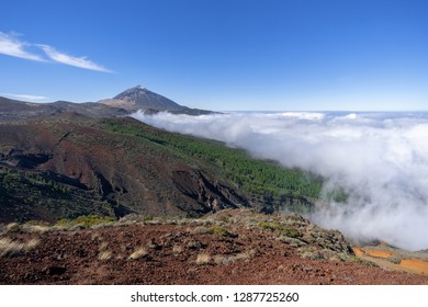 Ascending clouds in the natural landscape of the national park of Tenerife, Canary Islands with volcano Teide