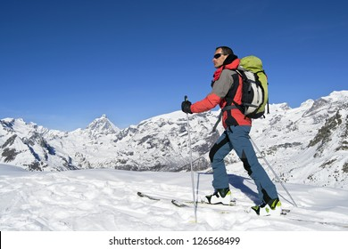 Ascending to the top. Ski mountaineering cross country skiing in Italian Alps, Cervino Matterhorn