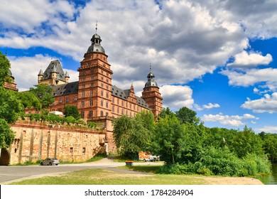 Aschaffenburg, Germany - July 2020: Palace called 'Schloss Johannisburg' and green park on sunny summer day