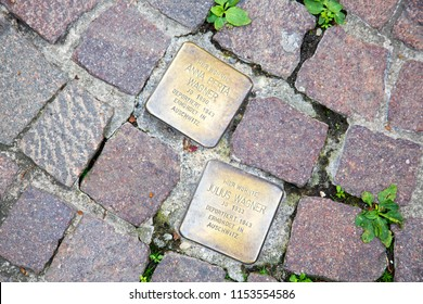 ASCHAFFENBURG / GERMANY / JUNE 2018. Stolperstein or stumbling stone in Aschaffenburg. Two cobblestones remembering the victims of the deportation and killing by the Nazis during the second world war.
