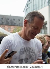 ASCHAFFENBURG, GERMANY -SEPTEMBER, 2014: German former boxing champion Henry Maske at a autograph session for fans on September 20, 2014 in Aschaffenburg, Germany