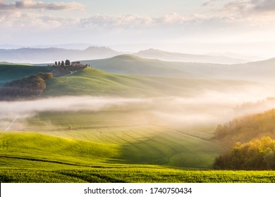 ASCIANO, ITALY - APRIL 14, 2016: Sunrise in Crete Senesi country region near Asciano, Tuscany, Italy