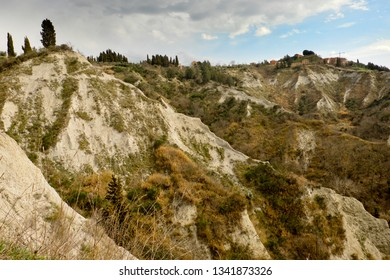 """Asciano (SI), Italy - March 07, 2019: Typical scenary of """"calanchii"""", a  geological formations near Asciano, Tuscany, Italy"""