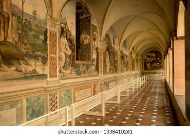 Asciano, Tuscany - Italy, March 7, 2019 Interior of Abbey of Monte Oliveto Maggiore. Frescoes surrounding the cloister of the Abbey