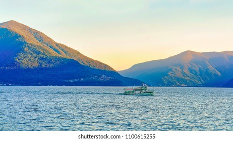 Ascona, Switzerland - August 23, 2016: Passenger ferry at the pier of the luxurious resort in Ascona on Lake Maggiore in Ticino, Swiss.