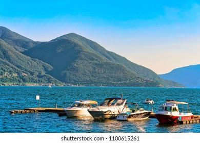 Ascona, Switzerland - August 23, 2016: Boats at the embankment of Ascona luxurious resort on Lake Maggiore in Ticino canton, Switzerland.