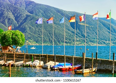 Ascona, Switzerland - August 23, 2016: Boats at the embankment of the luxurious resort in Ascona on Lake Maggiore in Ticino canton in Switzerland.