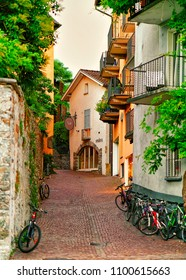 Ascona, Switzerland - August 23, 2016: Narrow street with bicycles at the luxurious resort in Ascona on Lake Maggiore of Ticino canton in Switzerland.