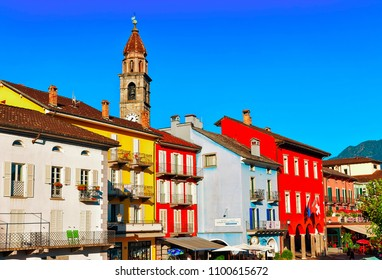 Ascona, Switzerland - August 23, 2016: St Peter and Paul church tower  and facades of buildings at the luxurious resort in Ascona on Lake Maggiore in Ticino canton in Switzerland.