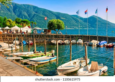 Ascona, Switzerland - August 23, 2016: Boats at the promenade of the luxurious resort of Ascona on Lake Maggiore in Ticino canton in Switzerland.