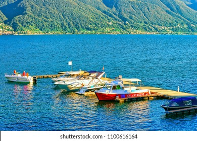 Ascona, Switzerland - August 23, 2016: Boats at the embankment of the luxurious resort in Ascona on Lake Maggiore in Ticino canton of Switzerland.