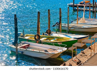 Ascona, Switzerland - August 23, 2016: Boats at the waterfront of the expensive resort in Ascona on Lake Maggiore in Ticino canton in Switzerland.