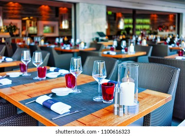 Ascona, Switzerland - August 23, 2016: Typical restaurant terrace with chairs and tables ready for a meal at the luxurious resort in Ascona on Lake Maggiore in Ticino canton in Switzerland.