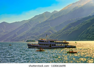 Ascona, Switzerland - August 23, 2016: Passenger ferry ship and catamarans the luxurious resort in Ascona on Lake Maggiore in Ticino canton in Switzerland. People on the background