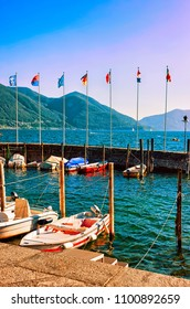 Ascona, Switzerland - August 23, 2016: Boats at the promenade of the luxurious resort in Ascona on Lake Maggiore in Ticino canton in Switzerland.