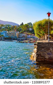 Ascona, Switzerland - August 23, 2016: Waterfront  of the expensive resort in Ascona on Lake Maggiore of Ticino canton in Switzerland.