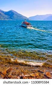 Ascona, Switzerland - August 23, 2016: Passenger ferry in the luxurious resort at Ascona on Lake Maggiore of Ticino canton in Switzerland.