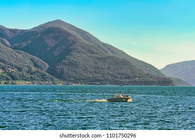 Ascona, Switzerland - August 23, 2016: Motor boat at the pier of the luxurious resort in Ascona on Lake Maggiore in Ticino canton in Switzerland.