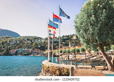 Ascona, Switzerland - August 23, 2016: Flags at the luxurious resort in Ascona on Lake Maggiore in Ticino canton in Switzerland.