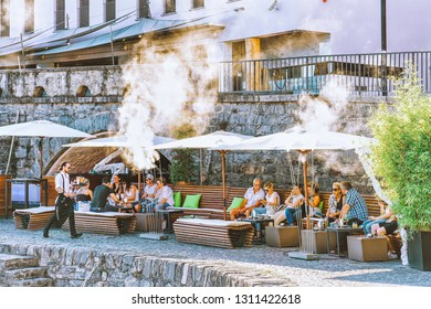 Ascona, Switzerland - August 23, 2016: People at street cafe in romantic luxury resort in Ascona town on Lake Maggiore in Ticino canton, in Switzerland. Outdoor expensive family Swiss restaurants