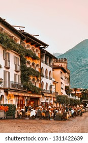 Ascona, Switzerland - August 23, 2016: Senior people at street cafe in romantic luxury resort in Ascona town on Lake Maggiore in Ticino canton in Switzerland. Outdoor expensive family restaurants