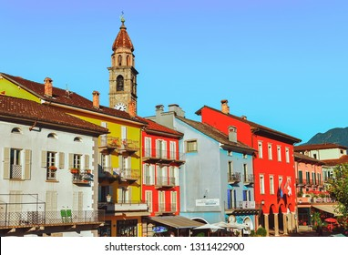 Ascona, Switzerland - August 23, 2016: Street with church at romantic luxury resort in Ascona town on Lake Maggiore of Ticino canton in Switzerland. Outdoor expensive family travel in Swiss city