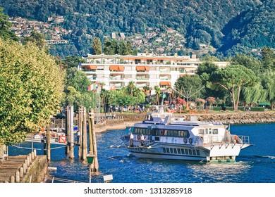 Ascona, Switzerland - August 23, 2016: Excursion passenger ferry on Ascona luxury tourist resort in Lake Maggiore, Ticino canton in Switzerland in summer. Outdoor travel. Swiss sailing in cruise ship