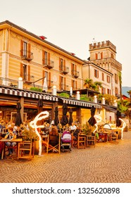Ascona, Switzerland - August 23, 2016: People at street cafe in romantic luxury resort in Ascona town on Lake Maggiore, in Ticino canton in Switzerland. Outdoor expensive family restaurants in Swiss