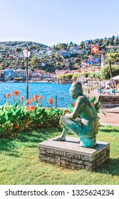 Ascona, Switzerland - August 23, 2016: Woman sculpture in Ascona luxury tourist resort promenade on Lake Maggiore in Ticino canton in Switzerland in summer. Romantic Swiss holiday. Lady figurine