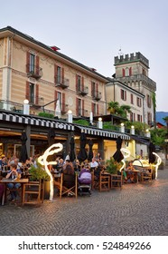 Ascona, Switzerland - August 23, 2016: Cafes and restaurants at the expensive resort in Ascona on Lake Maggiore, in Ticino canton, Switzerland. People on the background.
