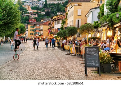 Ascona, Switzerland - August 23, 2016: People relaxing and dining at Street Restaurants in Ascona town on Lake Maggiore in Ticino canton, Switzerland.