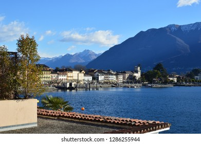 ASCONA, SWITZERLAND - JANUARY 2, 2019 - Colorful buildings in Ascona and the view from the old town on the Maggiore Lake, Ticino