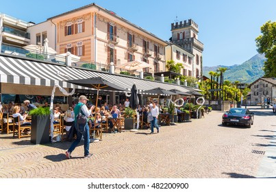 ASCONA, SWITZERLAND - MAY 4, 2016: Ascona located on the shore of Lake Maggiore and famous for its Old Town and a lake promenade which is dotted with street cafés, shops and boats.