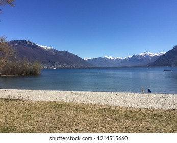 Ascona tessin beach landscape at Lago Maggiore in spring with snow on mountaintop in background. Ascona Locarno, CH Switzerland. 27th March 2016
