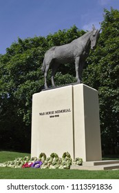 Ascot, Berkshire / UK - June 15 2018: A memorial to war horses that lost their lives during World War One. The bronze sculpture was designed by Susan Leyland, and located close to Ascot racecourse.