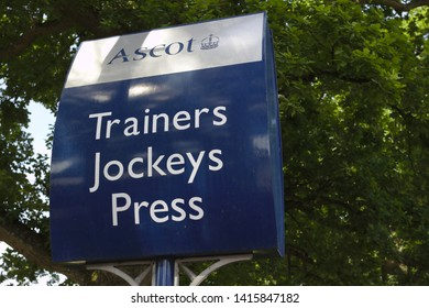 Ascot, Berkshire / UK - June 15 2018: Parking signs for visitors to Ascot racecourse - the venue of the Royal Ascot meeting