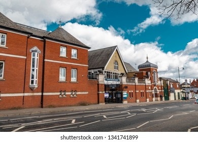 Ascot, England - March 17, 2019: Street view of the library of the town of Ascot, famous for its horse racing worldwide.