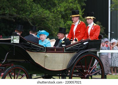 ASCOT - JUN 19: Queen Elizabeth II and Prince Philip, Duke of Edinburgh attend Ladies Day at Royal Ascot at Ascot racecourse on Jun 19, 2014 in Ascot